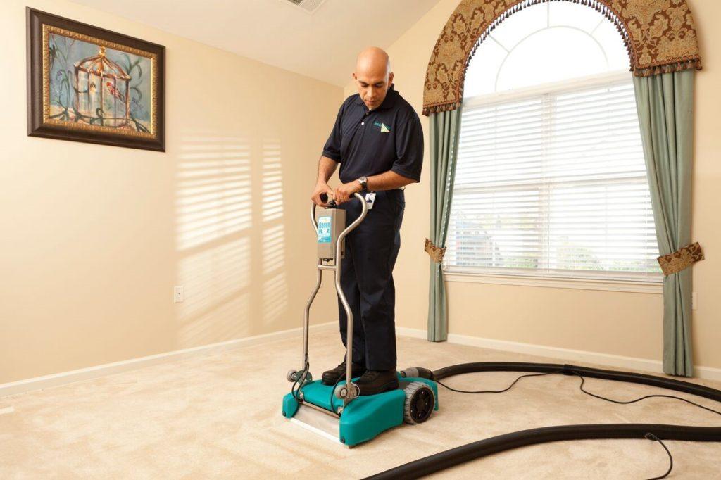 technician using carpet cleaning machine