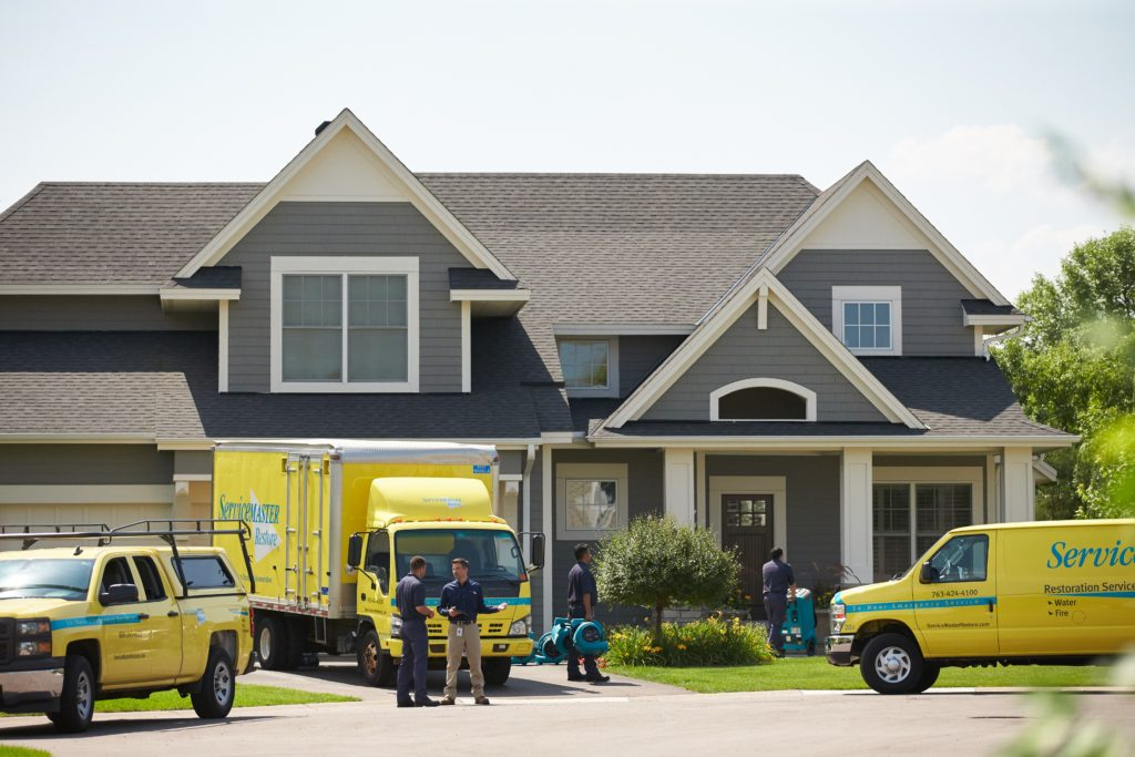 servicemaster vehicles in front of home
